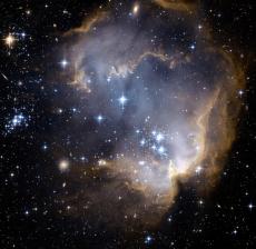 NGC 602 и за ним.