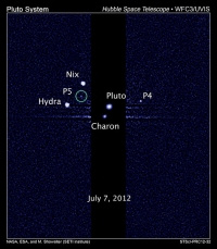 Самый крупный спутник Плутона был впервые запечатлен американским зондом New Horizons