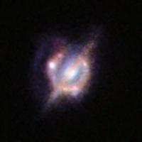 Потрясающий снимок сливающихся галактик в ранней Вселенной